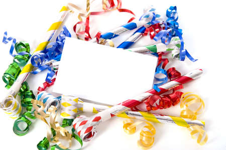 A blank note card surrounded by ribbons, streamers and party noise makers.  New Years eve or birthday party theme photo