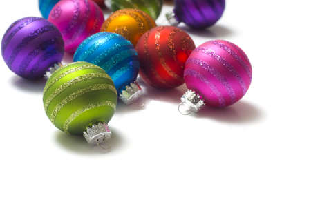 Colorful striped Christmas baubles or ball on a white background with copy space Stock Photo