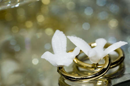 A macro of love bird ring decorations for a 50th wedding anniversary with copy space