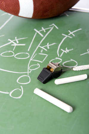 A diagram of a football play on a chalkboard with a football, chalk, eraser ane a whistle Banco de Imagens - 4753826