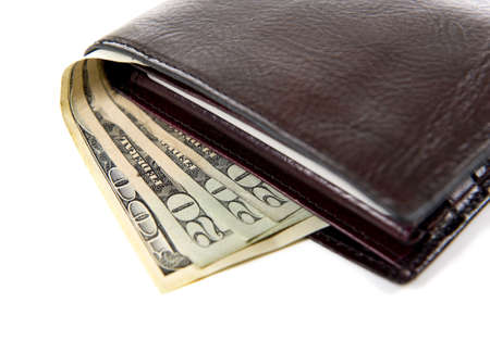 A brown leather wallet with money sticking out on a white background Banco de Imagens