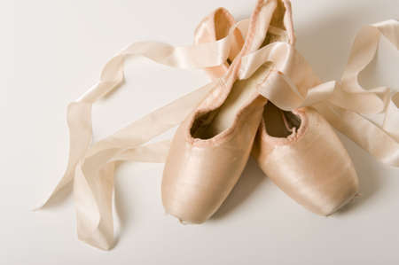 one item: A pair of ballet shoes on a white background Stock Photo