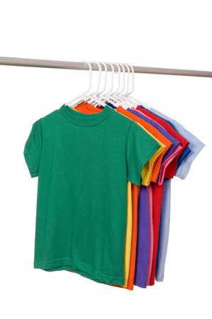 A row of colorful row t-shirts hanging on hangers on a white background, add copy or graphic to front of shirt Imagens