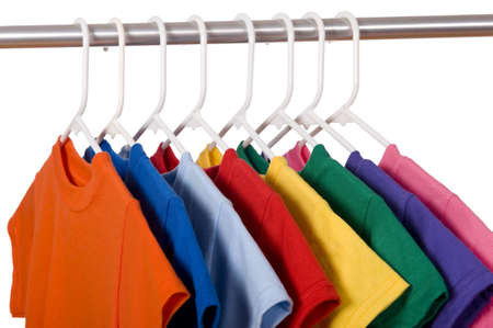 hangers: A row of colorful row t-shirts hanging on hangers on a white background Stock Photo