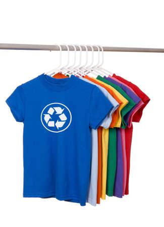 A group of brightly colored t-shirts on a white background with a recycle symbol on the front.