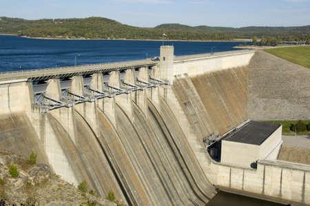 An energy producing dam at a lake