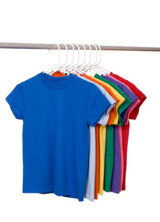 A row of colorful row t-shirts hanging on hangers on a white background Imagens