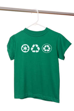 A green t-shirt on a hanger with recycle symbols on a white background with copy space Imagens - 5193327
