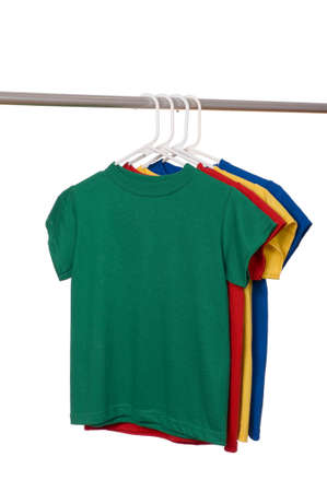 A row of colorful row t-shirts hanging on hangers on a white background Imagens - 5193411