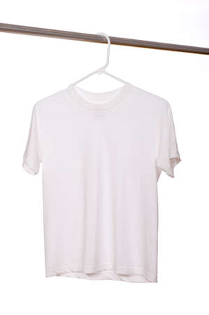 A white blank t-shirt hanging in front of a white background Imagens - 5193004