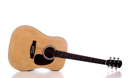 A wooden acoustic guitar on a white background with copy space Banco de Imagens
