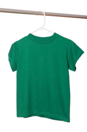 A green t-shirt on a hanger on a white background with copy space Imagens