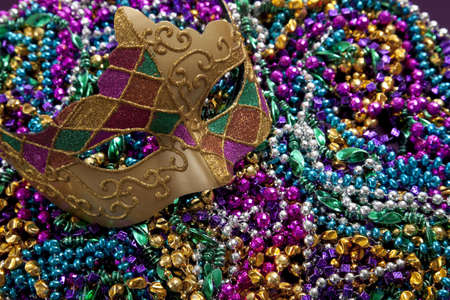 mardi gras mask: A group of mardi gras beads an mask with copy space