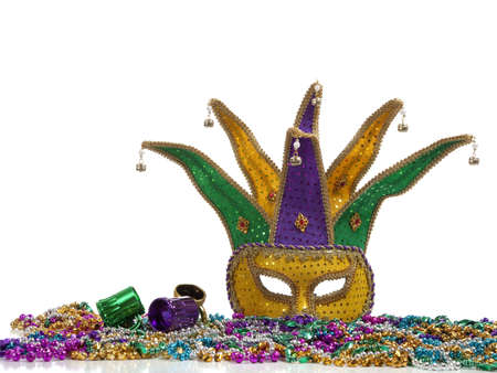 jester: A group of mardi gras beads an mask with copy space