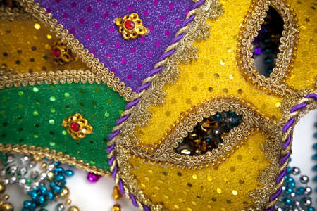 beads: A group of mardi gras beads an mask with copy space