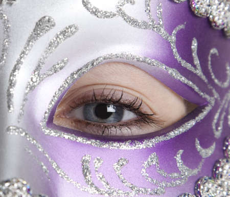 mardi gras mask: A girl in a halloween or mardi gras mask on a white background Stock Photo