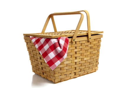 wicker basket: A wicker picnic basket with a red gingham cloth on a white background