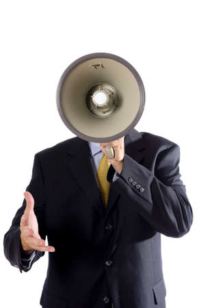 A man in a business suit with a megaphone making an announcement while gesturing,