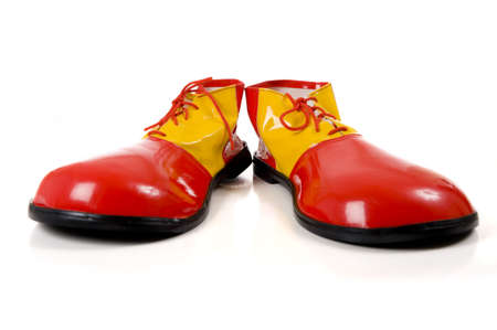 A pair of huge colorful clown shoes on a white background with copy space Zdjęcie Seryjne
