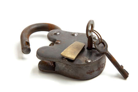 An old, antique vintage lock with keys on a white background photo