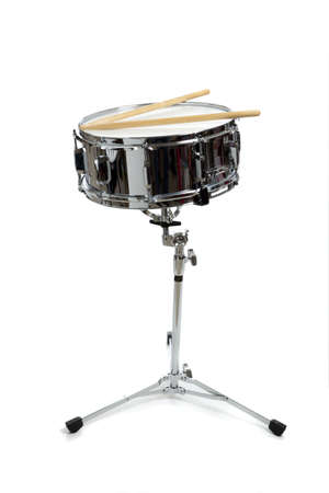 snare: A snare drum on stand on a white background with drumsticks.  Percussion Instrument
