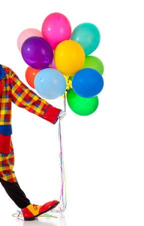 A clown holding balloons on a white background with copy space photo