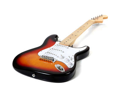 fender stratocaster: An electric guitar on white with extended depth of field- stratocaster copy Stock Photo