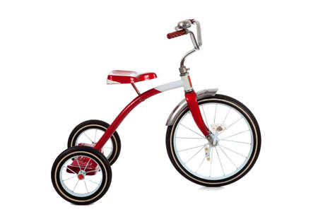 antique tricycle: A red toy tricycle on a white background with copy space