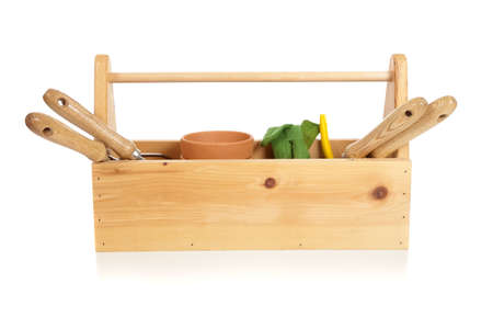 garden tool: A gardeners tote box on a white background with tools, plants and gloves