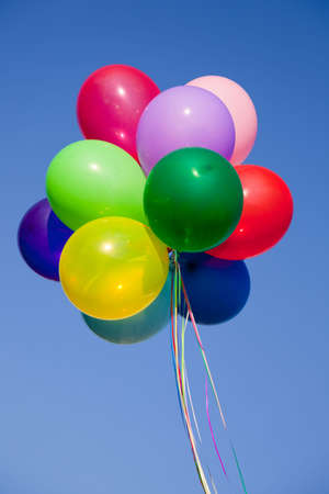 flotation: A group of colorful balloons with blue sky background