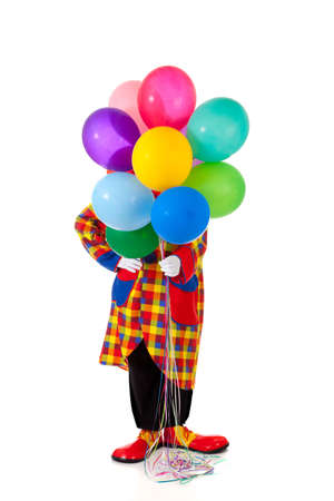 red balloon: A clown holding balloons on a white background with copy space
