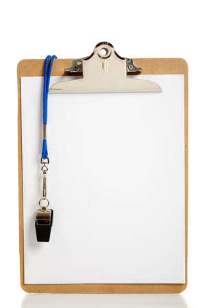 coach: A blank clipboard and a coaches whistle with copy space