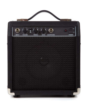 A guitar amp or amplifier on a white background.  Communication or message concept photo