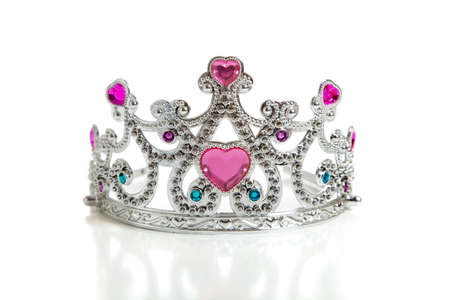 queen of diamonds: A childs toy princess tiara on a white background with copy space