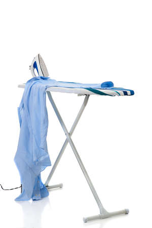 An ironing board with iron and a shirt on a white background