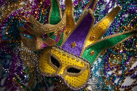 colorful beads: A group of mardi gras beads an mask with copy space