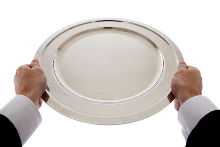 A silver empty tray held by a waiter, butler or server on a white background photo