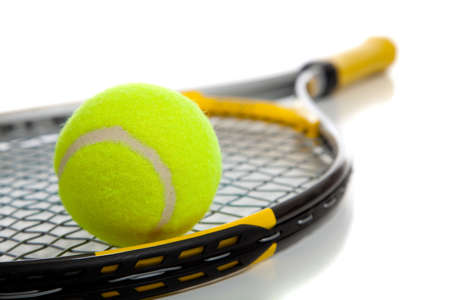A colorful tennis ball and racket on a white background with copy space