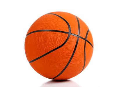 コピー領域の白い背景の上のゴム製バスケット ボール 写真素材