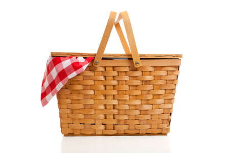 basket: A brown wicker picnic basket on a white background with gingham cloth Stock Photo