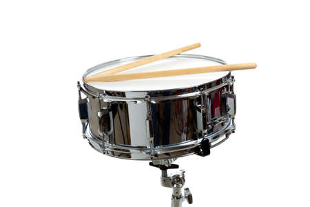 snare: A snare drum with drum sticks on a white background