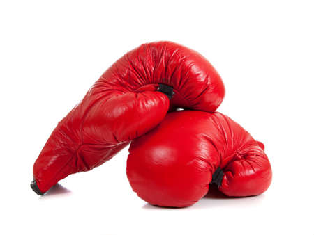 A set of red boxing gloves on a white background with copy space