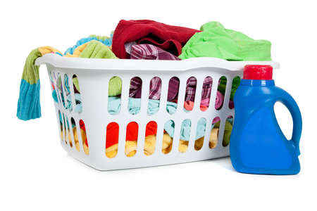 an overflowing laundry basket with a bottle of soap photo