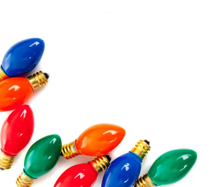 A group of Christmas light bulbs on a white background with copy space