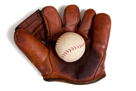 old items: A vintage, antique leather baseball glove with a baseball on a white background