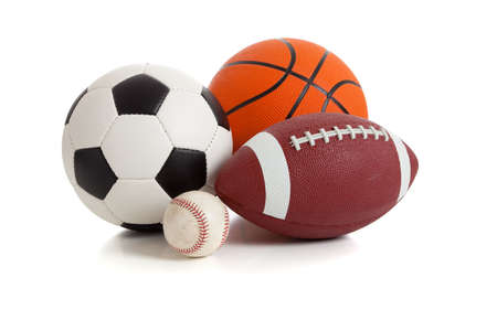 equipment: Assorted sports ball on a white background.  Includes a soccer ball, a football, a basketball and a baseball Stock Photo
