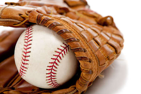 Brown leather baseball glove with a baseball on a white background Stock Photo - 5452102