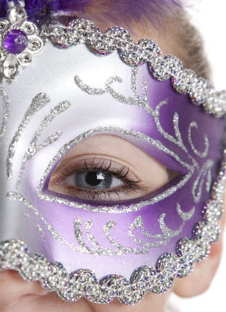 halloween eyeball: A girl in a halloween or mardi gras mask on a white background Stock Photo