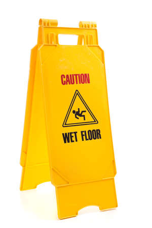 A yellow sign with the words caution, wet floor  on a white background photo