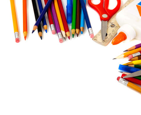 school objects: Assorted school supplies, including pens, pencils, scissors, glue and a ruler, on a white background